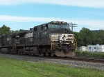 NS 9424 leads a train west