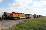 BNSF 4914 Runs Past a Grain Train with a Hot Z Consist