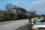 SBD 8049 passes passengers for following excursion train