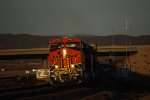 The Setting Sun Reflects her Rays off BNSF 6833's Very, Very Brand New BNSF/GE Swoosh New Logo Paint as she heads west!!!