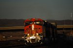 Into the cab shot of a Very, Very Brand New BNSF 6833 ES44C4 as they head into the Setting California Sun as they head west towards LA.