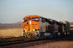 The Sun Glows Off BNSF 6833's BNSF Swoosh Logo as she heads west with the S LPC-SCL Double Stack.