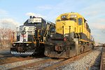 NYS&W SD40 # 3018 poses alongside  NS 3010 at PC yard