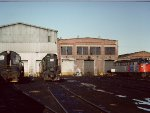 PC Alco RS11 and other power - New Haven diesel shop -1976
