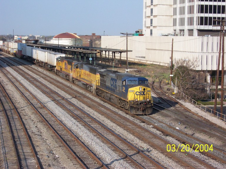 CSX train 120 passes Amtrak station