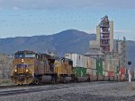 UP 5325 flies past the Lehigh Cement plant as it nears the summit at Tehachapi