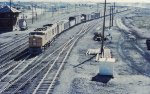 "Titled ""Westbound freight headed by gas turbine loco leaves Cheyenne. 1955"