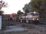 Under the fading sun, BNSF 9768 & 9425 put all of their muscle to the rails as the lift N956 out of town