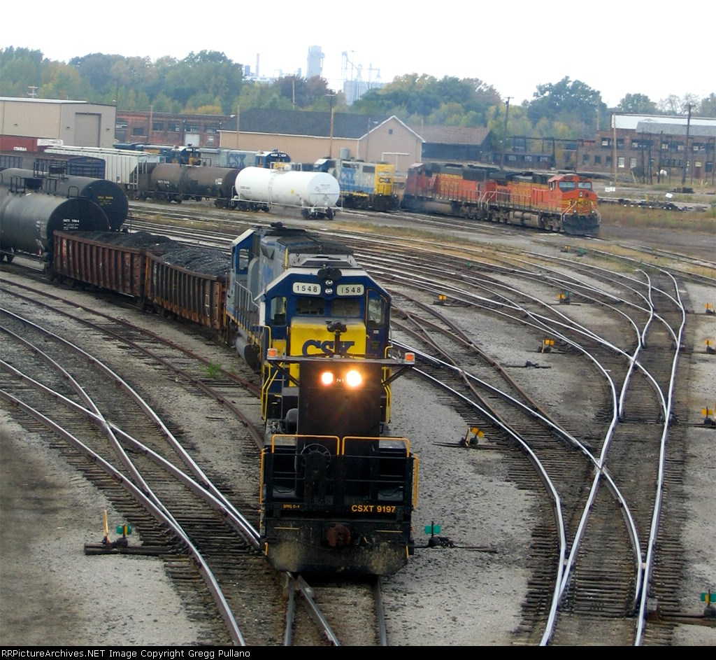 CSX GP15s switch the yard with an RCO Sled