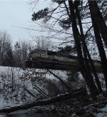 Q377 with executive SD70MAC emerges from the woods