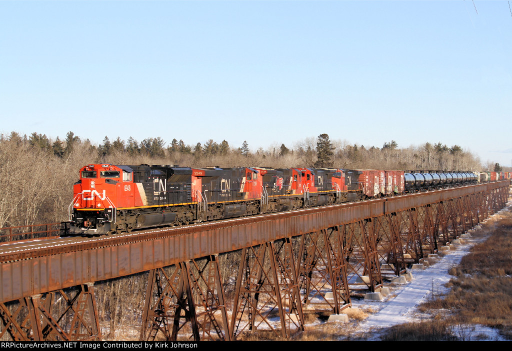 A Westbound CN Freight Makes a Pass Over the Massive Steel Bridge