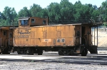 DRGW 01457, Steel Riveted Caboose, sits in storage at the Passenger Station