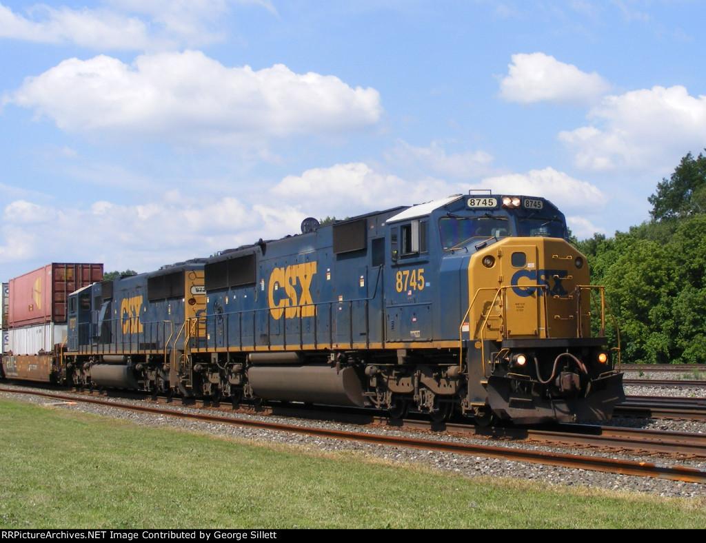A pair of CSX SD60!'s power a train east.