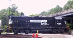 NS 7058 switches a cut of cars in the yard