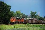 BNSF 6147, 9352 roll a KCPL train west
