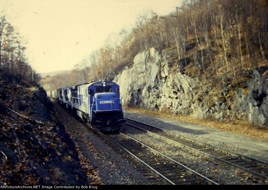 CR 6566 eases a mixed freight down the hill through the Middlefield gorge on the B&A