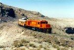 Alco pulling a Passenger train thru the harsh Peruvian Desert