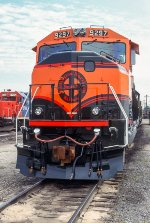 BNSF 9297, EMD SD60M, wearing Heritage test paint schemes, one varation on either side of the locomotive but different from the other.