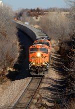 BNSF 5748, 6088, GE ES44AC EVO's, lead westbound empties past an eastbound coal load on the Ravenna Sub
