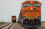 BNSF 5973, ES44AC, holds the siding while westbound empties pass by