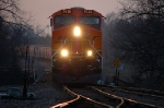 BNSF 7630 leads an empty grain train eastbound in the last light of day