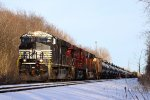 NS 8111 Leads a colorful consist on a rerouted oil train