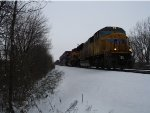 UP 3952 and KCS 4108 pull Q132 though the snow