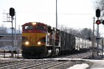 A Suprise Westbound KCS ACe Leads a BNSF Grain Train