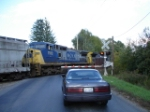 CSX 7912 & CSX 7391 cross over Peck Rd. headed for the Detector NB