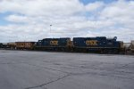 GP15-1s arriving with a caboose