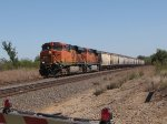 BNSF 7612 leads a grain wb,