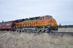 BNSF 6860 as DPU on Westbound Grainer