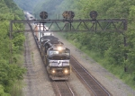 NS 6782 on pig train 21J passing the PRR signal bridge