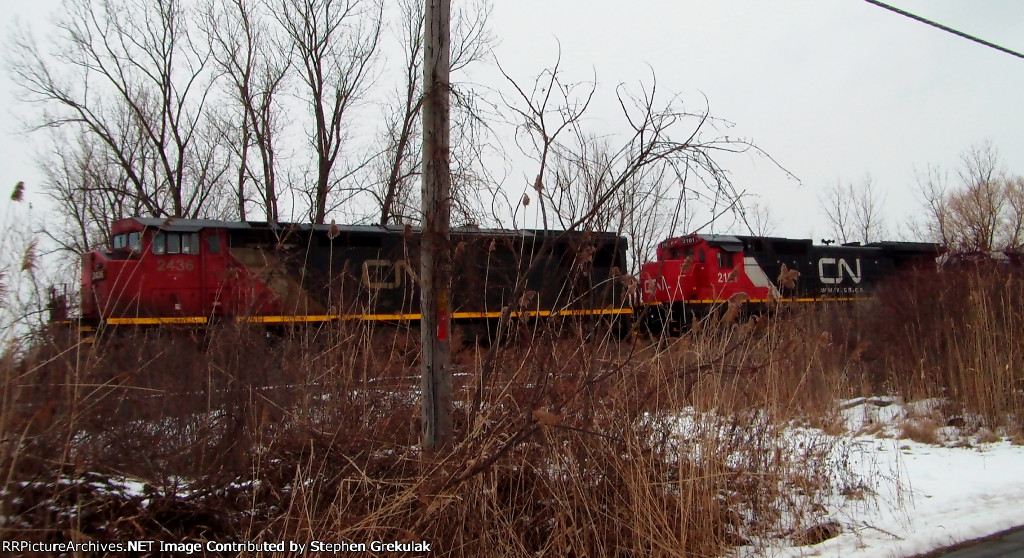 CSX WB Manifest with Idling CN Power in the Lead