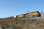 BNSF 6687 heads a eastbound across a small creek.