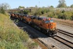 BNSF 7843 leads a 4 unit stack west.