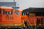 BNSF 6911 sticks her nose out between BNSF 7515 and BNSF 7220 as she sits on the Fuel Island.
