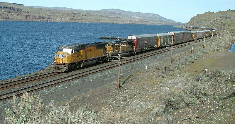 This autorack train got stuck behind the grain train