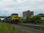 CSX 9000 Leads Along The City