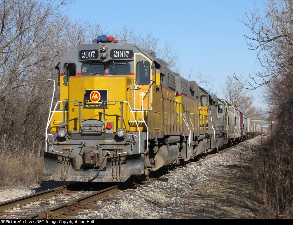 Z151 waits for the okay to come down onto CSX track with 3 cars of general freight and a grain train