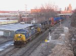 Rerouted due to a derailment in Indiana, Q004 heads east by Pleasant St