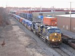 Rerouted intermodals meet as Q015 slowly rolls up to Pleasant St as Q004 passes