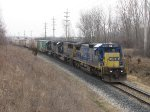 Led by CSX 7640, R389-07 drifts downhill between Fox and Seymour