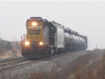 CSX 2680 heads east through the morning mist with Y106