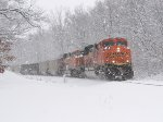 E945-13 heads west through the heavy lake effect snow
