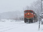 Its train disappearing back into the falling snow, E945 pulls into the yard on the mainline