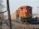 BNSF 9205 leads N956-08 through the yard on the main