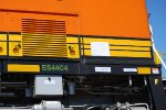 BNSF 6926's GE Data Plate and its New ES44C4 tag along the side rail.
