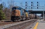 CSX E726 rolls under the signal bridge