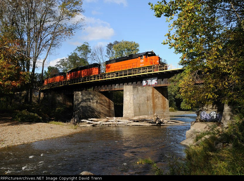 B&LE 867 leads 878 and 866 across the Hogback Bridge over Conneaut Creek with its loads of ore